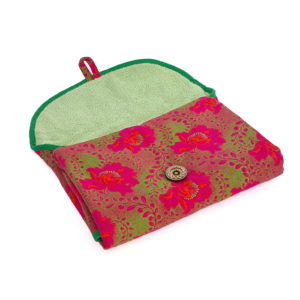 Wonderlands_baby gift_ handmade changing mat_Pink flowers and a green foliage on a pink background_Three Cats shweshwe_cotton towel of verdant colour_open