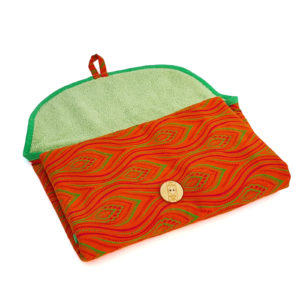 Wonderlands_baby gift_ handmade changing mat_Pink and green feather like shape on an orange background_Three Cats shweshwe_cotton towel of verdant colour_open