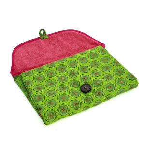 Wonderlands_baby gift_ handmade changing mat_Green & orange fireworks like shape on a green background_Three Cats shweshwe_ cotton towel of pink colour_open