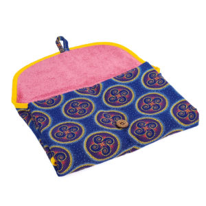 Wonderlands_baby gift_ handmade changing mat_Yellow circles with a blue and orange pattern on a blue background_Three Cats shweshwe_cotton towel of pink colour_open