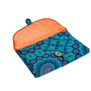 Wonderlands_baby gift_ handmade changing mat_Green & orange rosette on a blue background_Three Cats shweshwe_cotton towel of coral colour_open