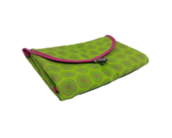Wonderlands_baby gift_ handmade changing mat_Green & orange fireworks like shape on a green background_Three Cats shweshwe_ cotton towel of pink colour_side