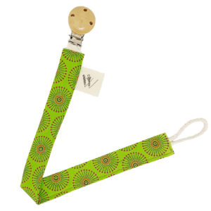 Wonderlands_baby gift_handmade pacifier clip_Coco C_Green & orange fireworks like shape on a green background_Three Cats shweshwe