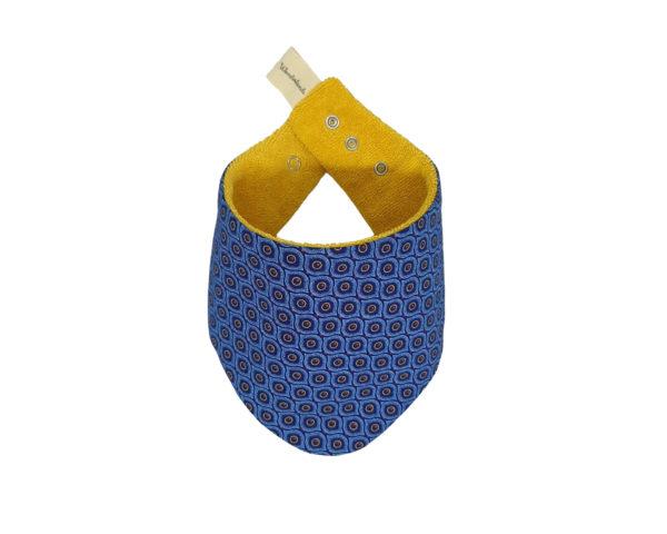 Wonderlands_baby gift_handmade bandana bib_Eyes like shape in blue_Three Cats shweshwe_cotton towel of golden colour_closed
